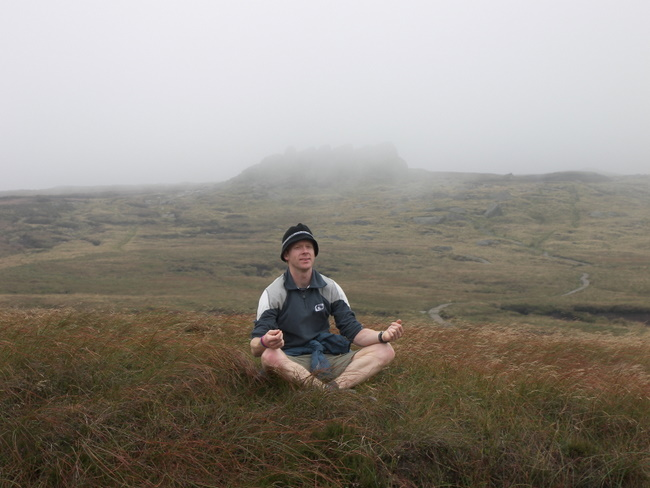 Darryl meditates (?) with Edale Rocks in the background